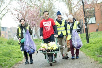 Tidy Up Tottenham members with wheelbarrow on clean up