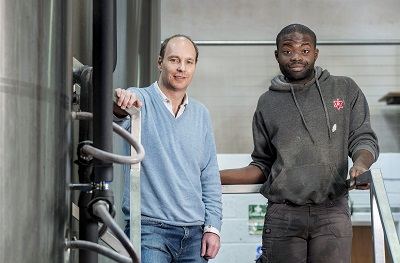 Andy Moffat, founder of Redemption Brewery with brewery assistant Stephen Kassay