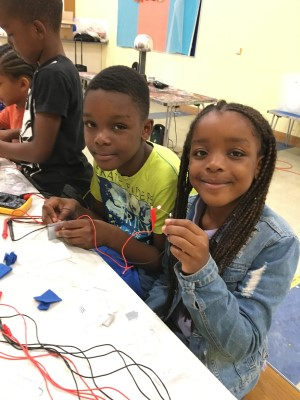 Two children experiment at STEM summer camp